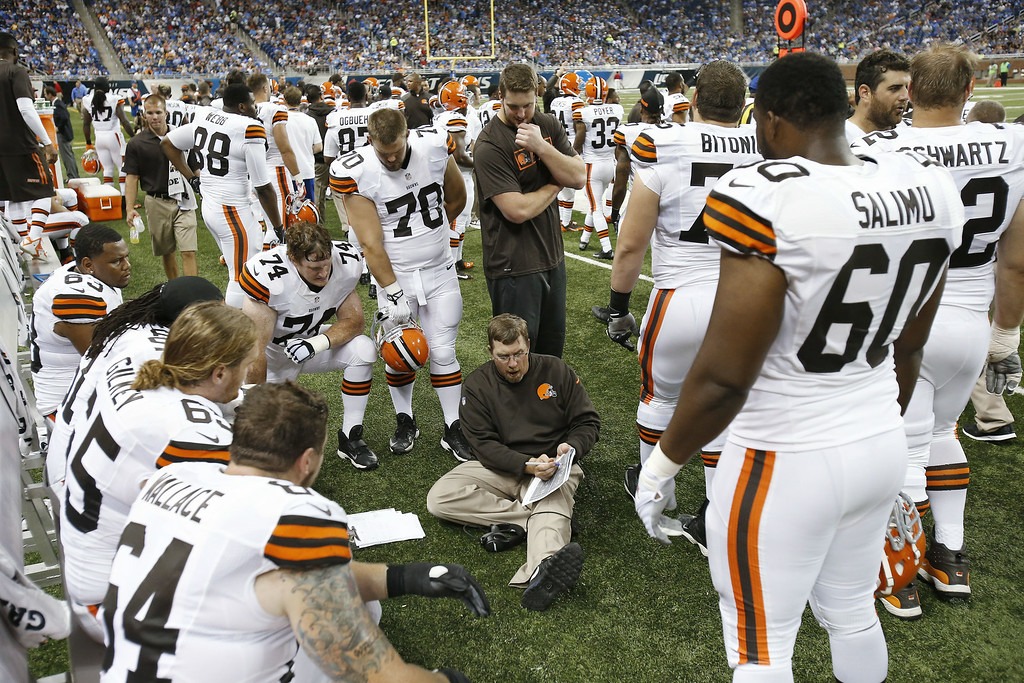 Description of . Cleveland Browns offensive line coach Andy Moeller talks with the line against the Detroit Lions in the second half of a preseason NFL football game at Ford Field in Detroit, Saturday, Aug. 9, 2014.  (AP Photo/Duane Burleson)