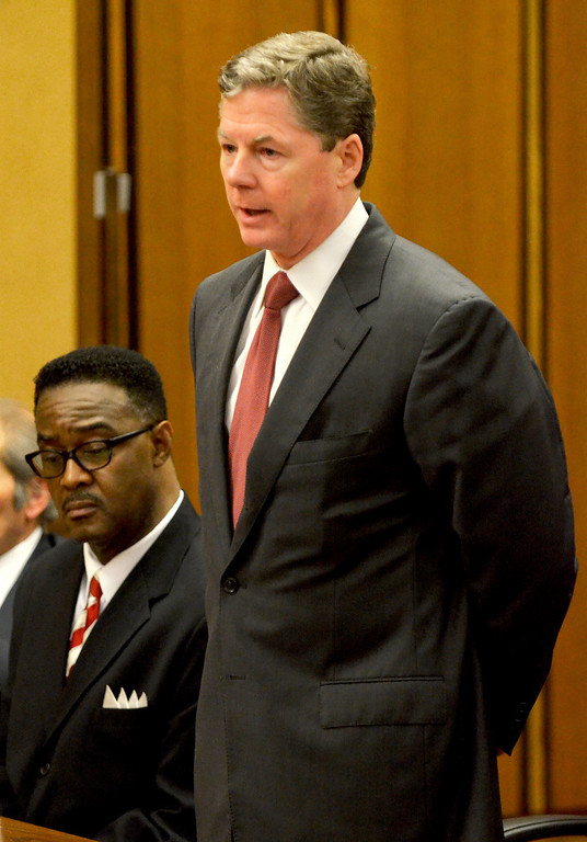 Description of . Jeff Forman/JForman@News-Herald.com Robert Moore, left, listens as his attorney John McCaffery speaks May 22 in Cuyahoga Common Pleas Court.