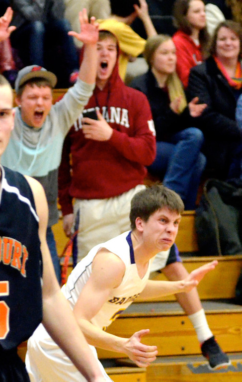 Description of . Jeff Forman/JForman@News-Herald.com Luke reacts and fans cheer as he makes his shot.