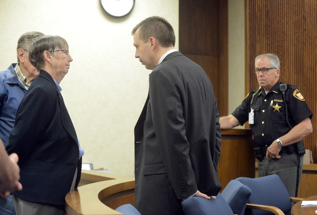 Description of . Duncan Scott/DScott@News-Herald.com Kevin Knoefel talks to family members during a break in testimony in Lake County Common Pleas Court on June 9, 2014, day six of Knoefel's trial on a charge of conspiracy to commit aggravated murder.