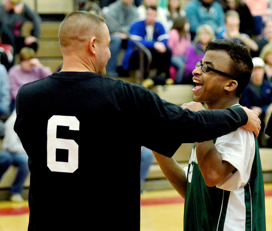 Description of . Jeff Forman/JForman@News-Herald.com Coach Dave Wojehowski, Harvey High School, shares a playful moment with Bobcats player Patrick Coffee during Broadmoor's game against area high school coaches March 24 at Mentor High School.