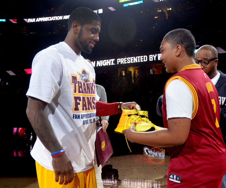 Description of . Michael Allen Blair/Digital First Media Cavs' guard Kyrie Irving gives his game shoes to Brandon Armstrong of Twinsburg after a game at Quicken Loans Arena on April 16.