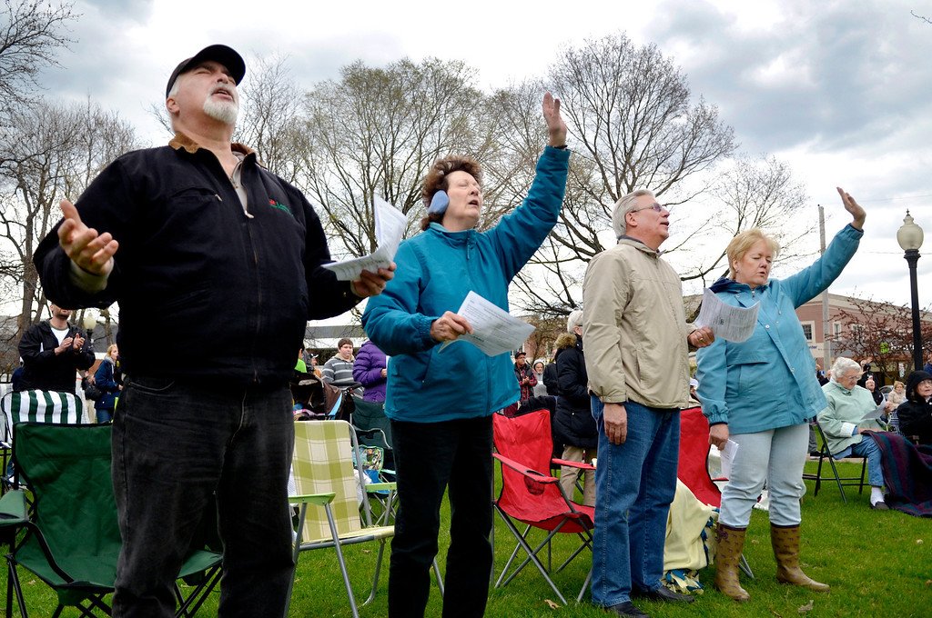 Description of . Jeff Forman/JForman@News-Herald.com Mark Steffens, left, Joy Yommer and Bob and Jennifer Higgins participate in a National Day of Prayer observance May 1 in Painesville.