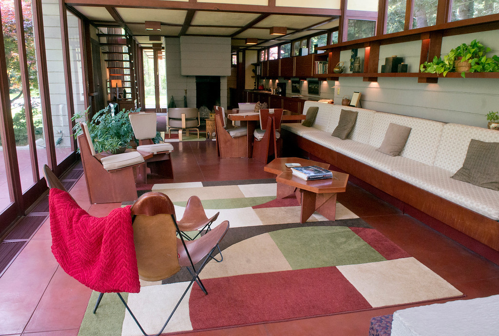 Description of . Duncan Scott/DScott@News-Herald.com A wall of 12-foot floor-to-ceilng windows bathes the living room in natural light in the Frank Lloyd Wright designed Louis Penfield House in Willoughby Hills.