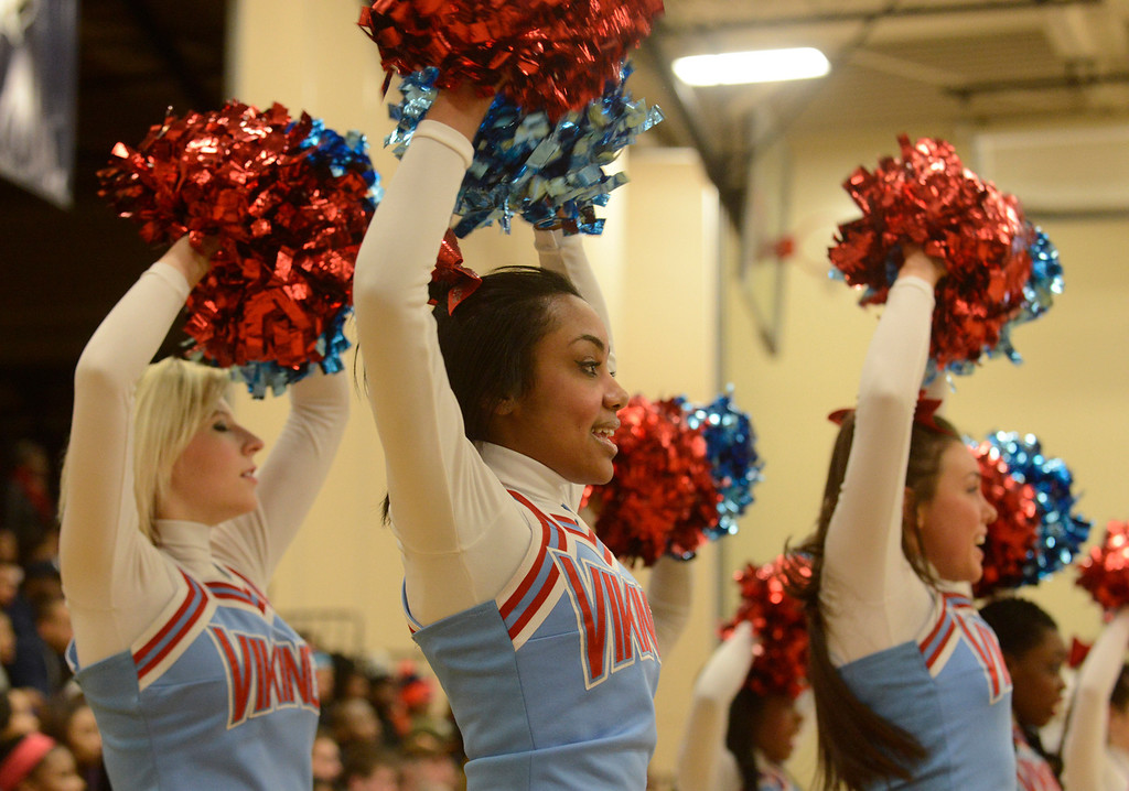 Description of . Maribeth Joeright/MJoeright@News-Herald.com<p>  Villa Angela-St. Joseph cheerleaders rally their team and their classmates during the district chamionship game against Warrensville Heights, March 7, 2014.