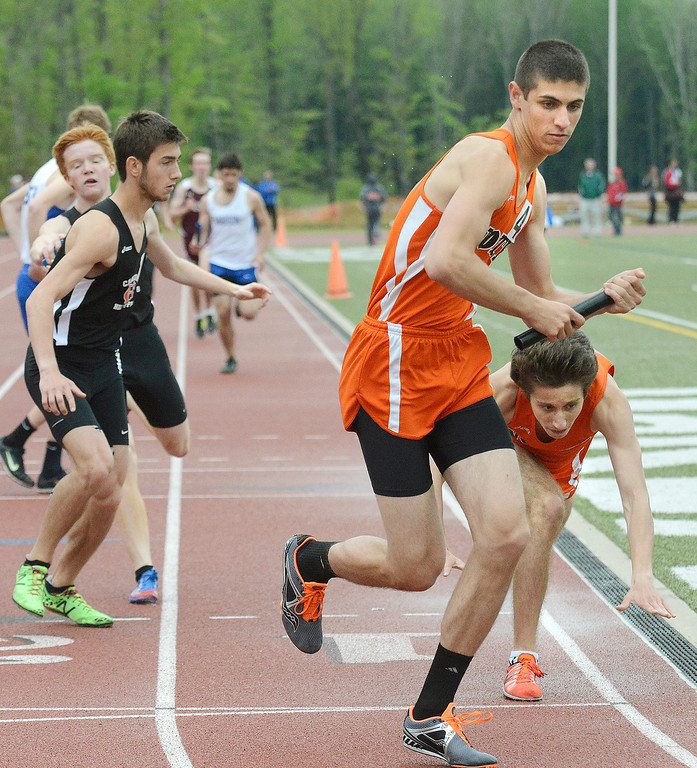 Description of . Maribeth Joeright/MJoeright@News-Herald.com<p> North's Dan Car collapses after handing the baton to his teammate and anchor Jack Petrecca in the boys 4X800 meter relay during the PAC meet at SPIRE Institute, May 15, 2014. North edged out Chardon to win the event.