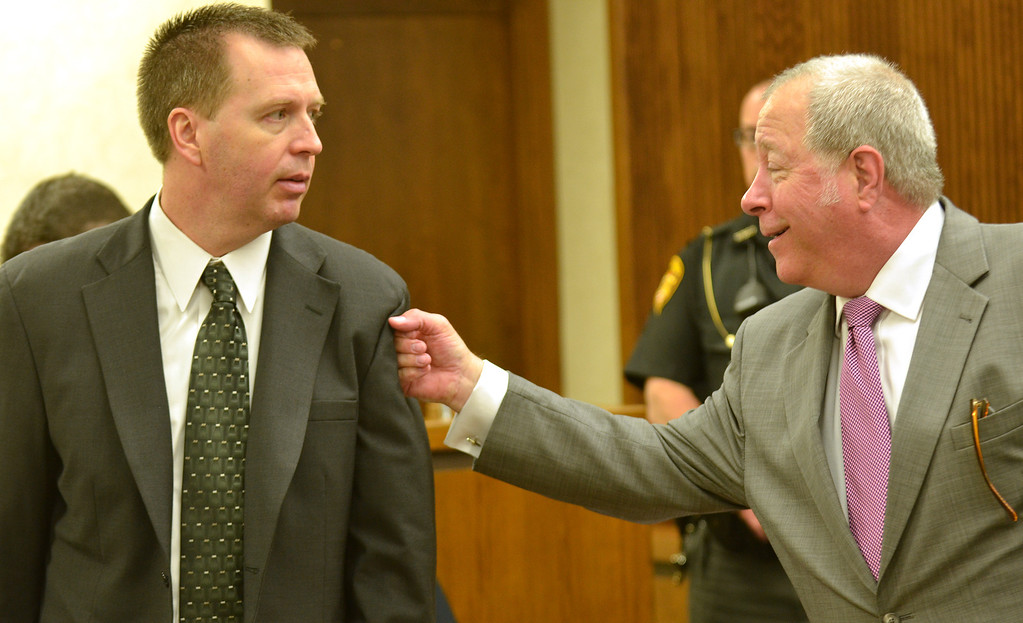 Description of . Michael Allen Blair/MBlair@News-Herald.com Kevin Knoefel, left, gets a playful punch in the arm by his defense attorney Michael J. Connick after the close of the first day of testimony for Knoefel's conspiracy trial in Lake County Common Pleas Court on  June 2, 2014.