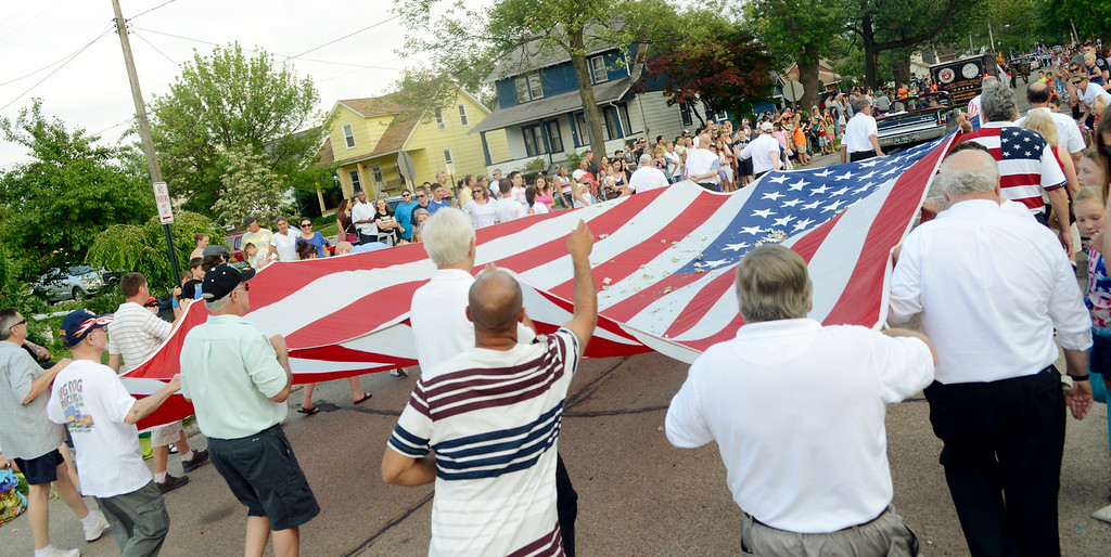 Description of . Maribeth Joeright/MJoeright@News-Herald.com<p> Members of the Painesville Elks carry a large flag during the Fairport Harbor Mardi Gras parade, July 2, 2014. The parade is the kickoff for the July 4th holiday festivities.