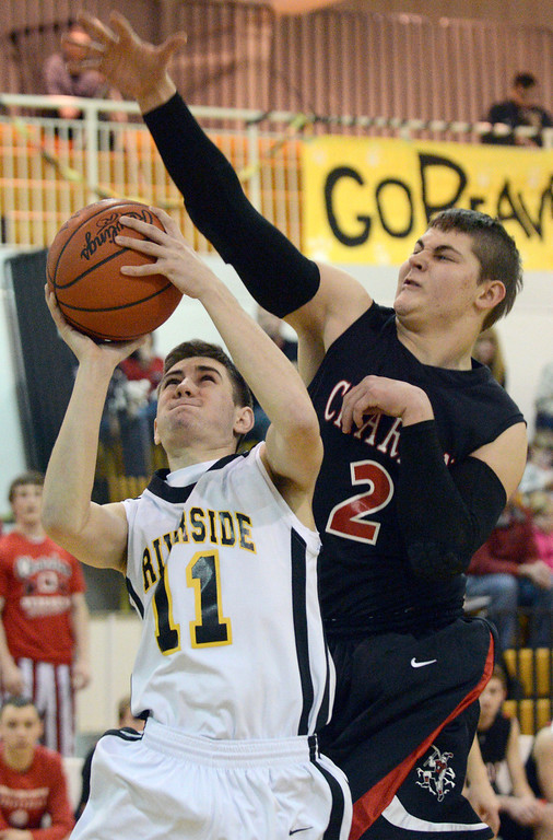 Description of . Duncan Scott/DScott@News-Herald.com Riverside's Tim Keller shoots in the first quarter defended by Chardon's Andrew Gray. Riverside won Friday's PAC matchup 49-43 at the Riverside Community Field House.