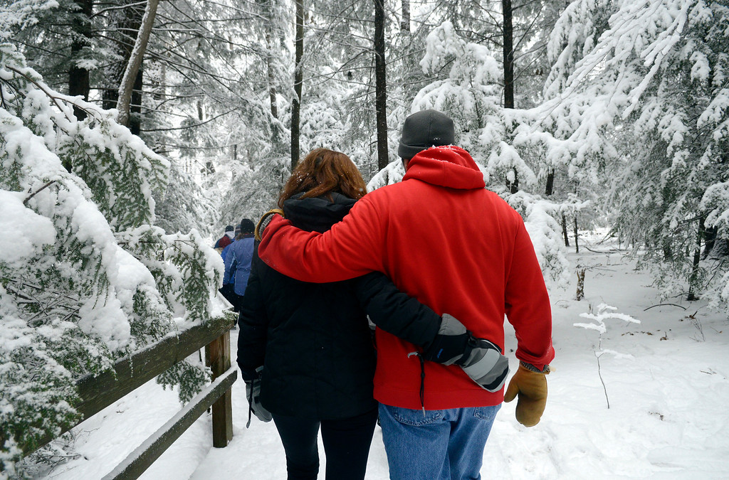 Description of . Maribeth Joeright/MJoeright@News-Herald.com A couple find closeness as they hike through a forest of hemlocks during the gorge hike at Lake Metroparks Penitentiary Glen.