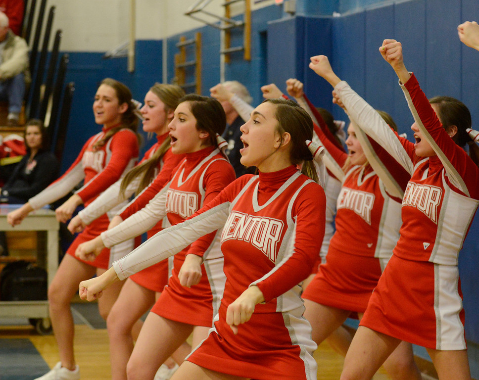 Description of . Maribeth Joeright/MJoeright@News-Herald.com<p> The Mentor varsity cheerleaders twist and shout their team to victory over Glenville in the Division I district semifinal game at Euclid High School.