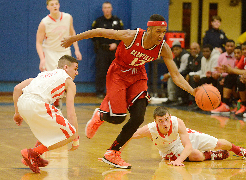 Description of . Maribeth Joeright/MJoeright@News-Herald.com<p> Glenville's Jonathan Walker steals the ball from Mentor during the second quarter of the Division I district semifinal game in Euclid, March 6, 2014.