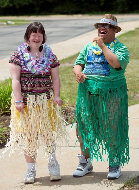 Description of . Duncan Scott/DScott@News-Herald.com Sarah Brewer and DeMarco Brown enjoy themselves at  a luau on June 18 at the Lake County Board of Developmental Disabilities/Deepwood Vocational Guidance Center.