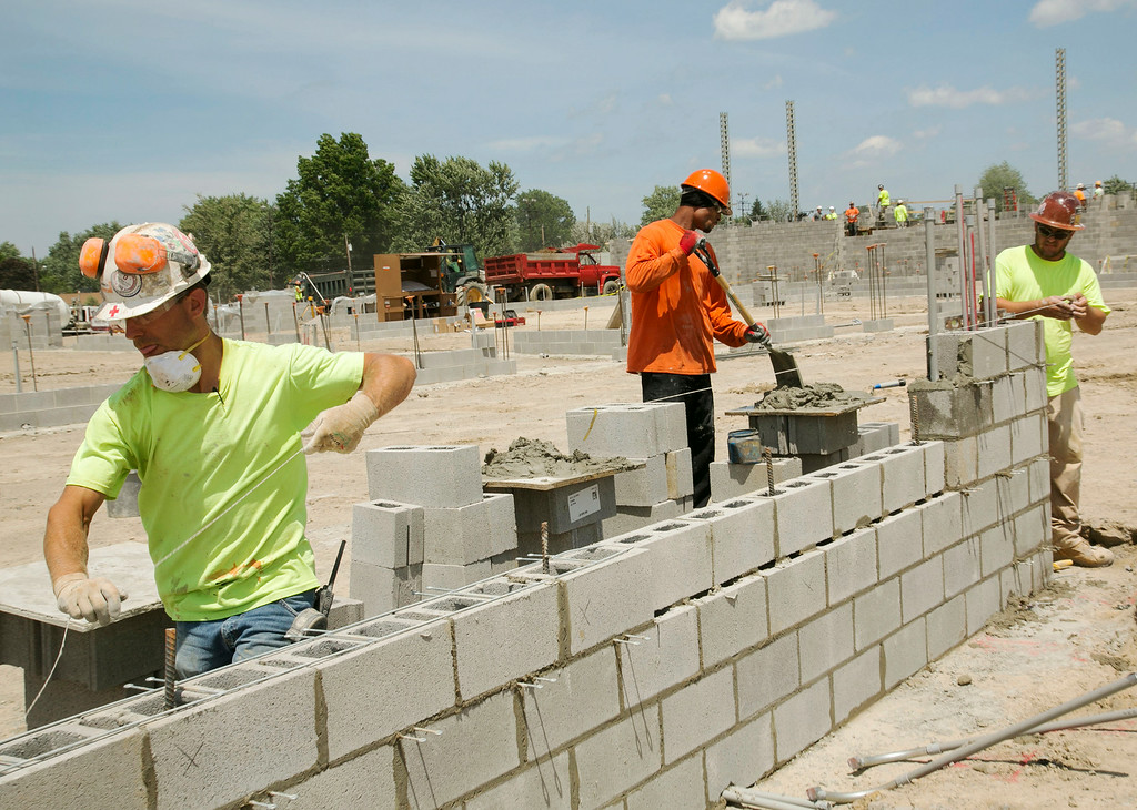 Description of . Michael Allen Blair/MBlair@MorningJournal.com Brick layers assemble a wall of what will be the part of the Lorain Sports Hall of Fame and Lorain County Historical Society inside of the new Lorain Admiral King High School in Lorain on June 30.
