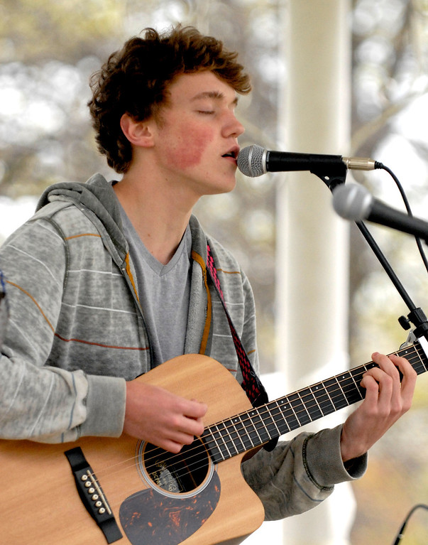 Description of . Jeff Forman/JForman@News-Herald.com Rob Huffman, 16, sings and plays guitar with other musicians from the Leory Community Chapel during a National Day of Prayer observance May 1 in Painesville.