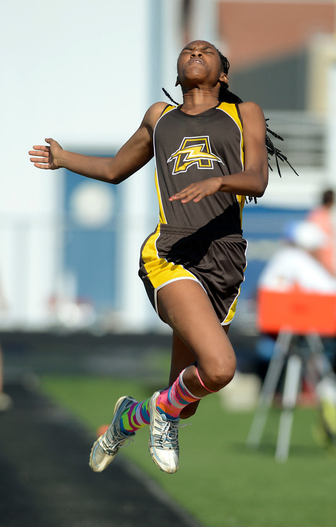 Description of . Maribeth Joeright/MJoeright@News-Herald.com<p> Brush's Asya Reynolds wins the girl's long jump event during the Division I track and field championships at Austintown Fitch High School, May 30, 2014. Reynolds will compete in the state meet next weekend.
