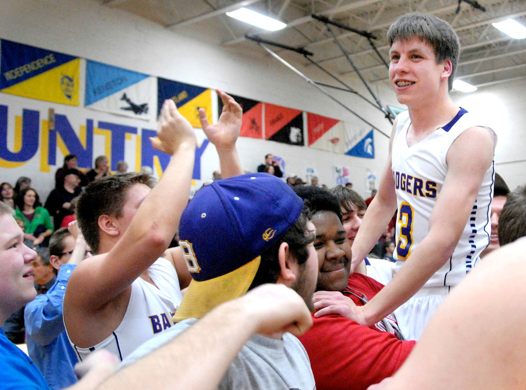 Description of . Jeff Forman/JForman@News-Herald.com Friends and teammates lift up Luke Freiling after the game.