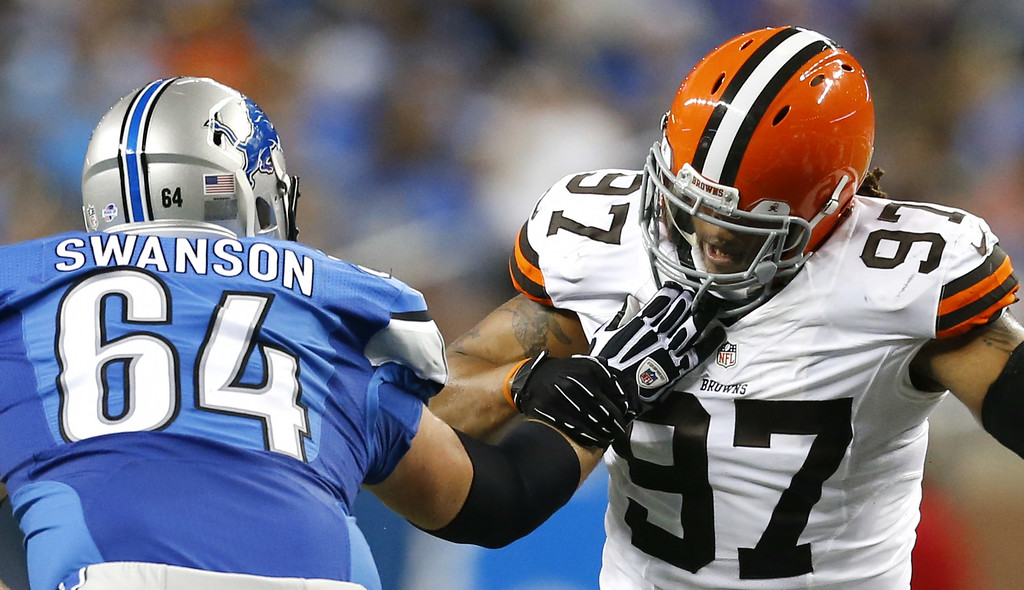Description of . Cleveland Browns outside linebacker Jabaal Sheard (97) fights off Detroit Lions center Travis Swanson (64) in the first half of a preseason NFL football game at Ford Field in Detroit, Saturday, Aug. 9, 2014.  (AP Photo/Rick Osentoski)