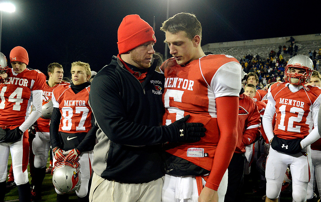 Description of . Maribeth Joeright/MJoeright@News-Herald.com<p> Mentor's Conner Krizancic is consoled by one of his coaches after their 55-52 loss to Archbishop Moeller in the Division I state final game against Archbiship Moeller, Saturday, in Canton.