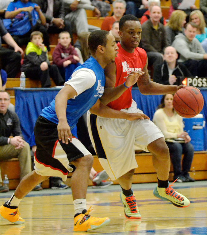 Description of . Jeff Forman/JForman@News-Herald.com Chavez Harper drives against Julio Stevens during the 36th News-Herald Classic March 29 at Lakeland Community College.