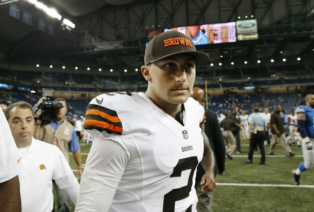 Description of . Cleveland Browns quarterback Johnny Manziel (2) walks off the field after losing to the Detroit Lions 13-12 in the a preseason NFL football game at Ford Field in Detroit, Saturday, Aug. 9, 2014. (AP Photo/Rick Osentoski)