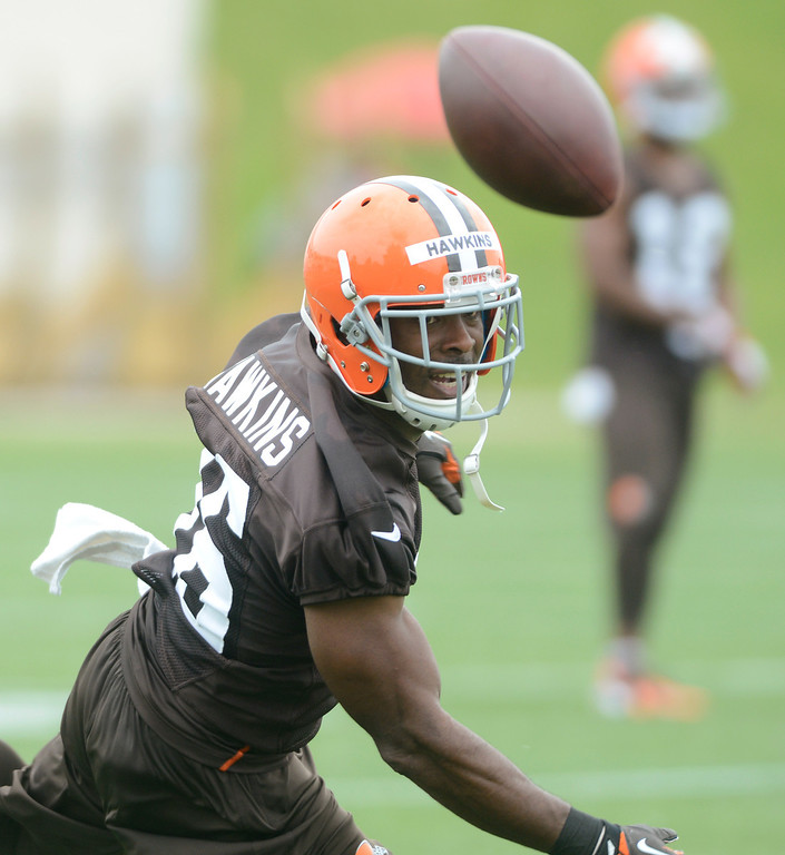 Description of . Maribeth Joeright/MJoeright@News-Herald.com <p> Browns wide receiver Andrew Hawkins reaches for a tipped pass during mini camp in Berea, June 10, 2014.