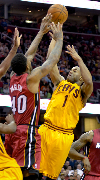 Description of . Jeff Forman/JForman@News-Herald.com The Cavaliers' Jarrett Jack shoots over Udonis Haslem during the second quarte March 18 at Quicken Loans Arena.