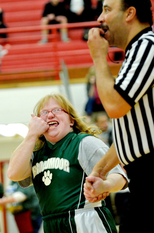 Description of . Jeff Forman/JForman@News-Herald.com Broadmoor Bobcats player Casey Cronan holds hands with referee Joe Hewitt as they move down court during the Bobcats game against area high school coaches March 24 at Metor High School.