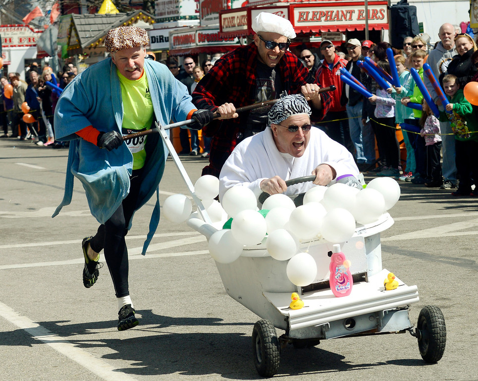 Description of . Maribeth Joeright/MJoeright@News-Herald.com<p> The Maple Marauders bathtub race team comprised of Kevin Morgan at the wheel, Bob Baird, left, and Drew Vargo push their way to the finish line during the annual event at 85th annual Geauga County Maple Festival on Chardon Square, April 27, 2014. The Maple Marauders took best of show for the creative costumes.