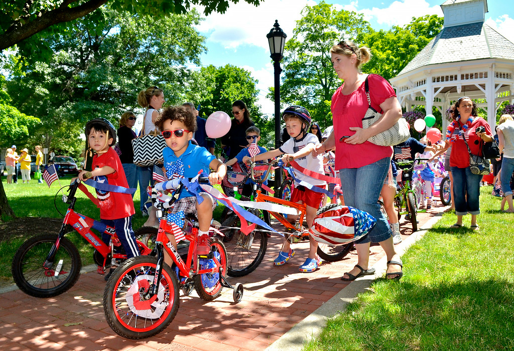 Description of . Jeff Forman/JForman@News-Herald.com Children line up on Chardon Square with ther decorated bikes for the July 4th Chardon Old Glory Day Parade.