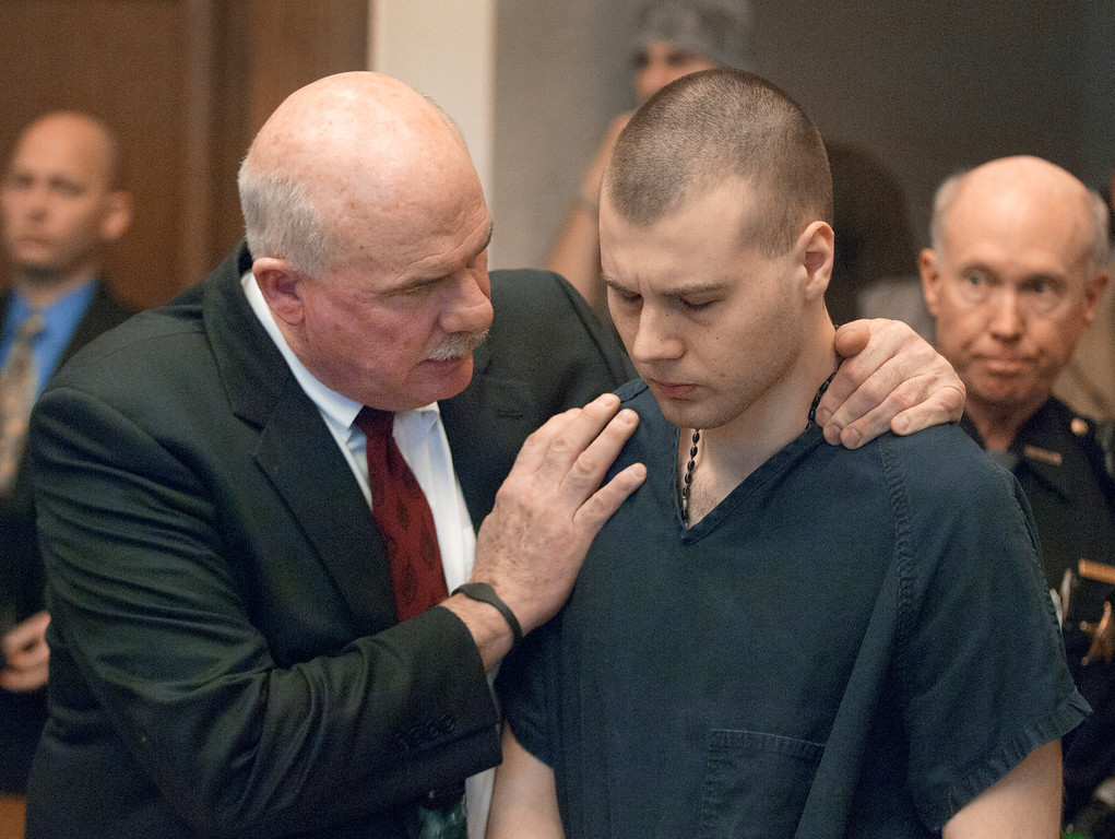 Description of . Duncan Scott/DScott@News-Herald.com John Luskin consoles Nathaniel Brown in Lake County Common Pleas Court on December 19, 2011, after Brown was sentenced to life in prison without parole for the murder of William Andrew Fayne Putzbach.