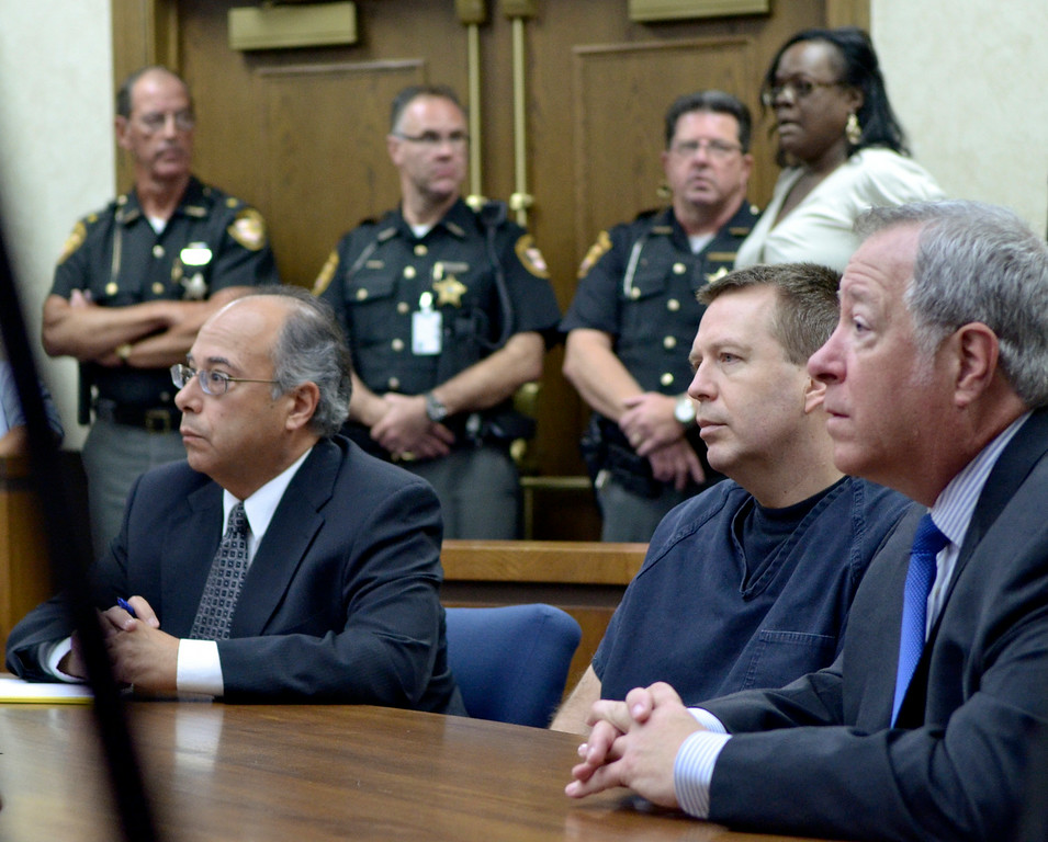 Description of . Jeff Forman/JForman@News-Herald.com Kevin Knoefel sits between his attorneys, Dennis LoConti, left, and Michael Connick, as Erika Gaiter speaks during Knoefel's sentencing for convincing his foster daughter to stab his wife to death. Gaiter was Lisa Knoefel's friend and boss at Cuyahoga County Jobs and Family Services.