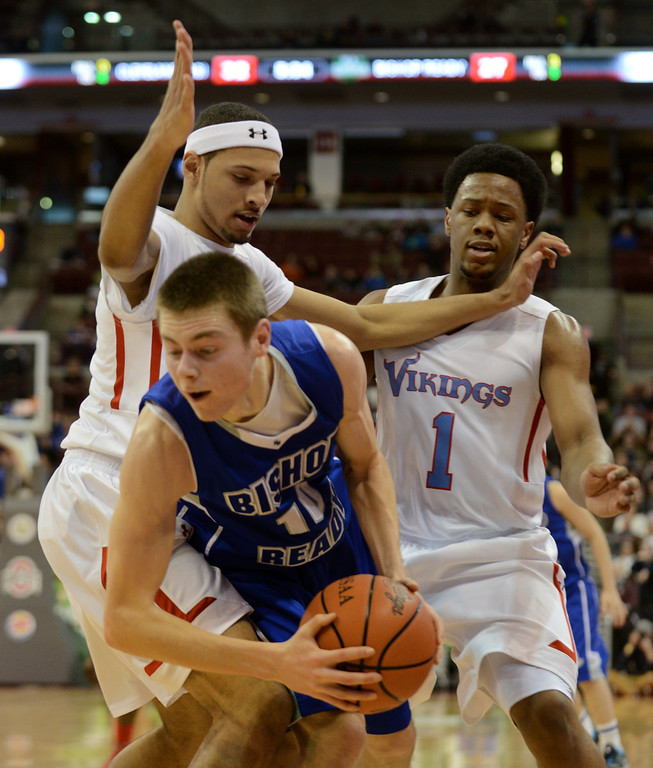 Description of . Duncan Scott/DScott@News-Herald.com VASJ's Tre'Von Williams and Brian Parker trap Columbus Bishop Ready's Jimmy Hanley in the third quarter. VASJ won the Division III state semifinal on March 21, 55-40, to advance to the state final on March 22.