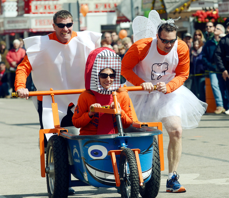 Description of . Maribeth Joeright/MJoeright@News-Herald.com<p> The Chardon Smile Center bathtub race team, dressed their part as they raced in the popular Geauga County Maple Festival event, April 27, 2014. Shown is Jen Hanaus at the wheel, Bryce Tischer, left, and Dr. Brian Titus.