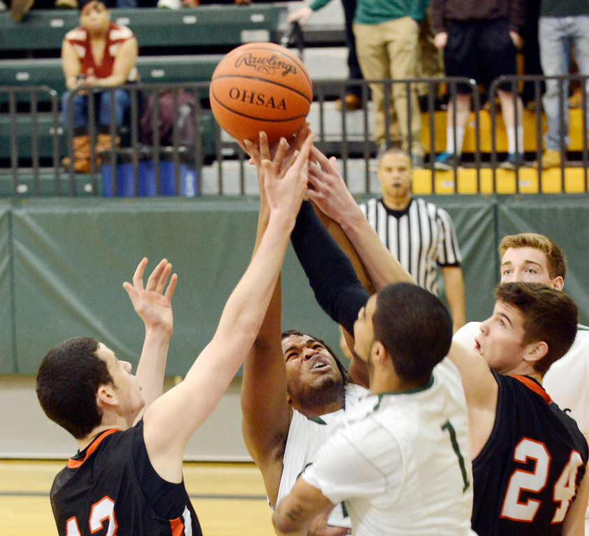 Description of . Maribeth Joeright/MJoeright@News-Herald.com<p> Chagrin's Jack Karyo, left, and Sawyer McGuire battle for the rebound with Lake's Kareem Haddix, left, and Zavier Powers during the first quarter of the Division II district final game, March 8, 2014.