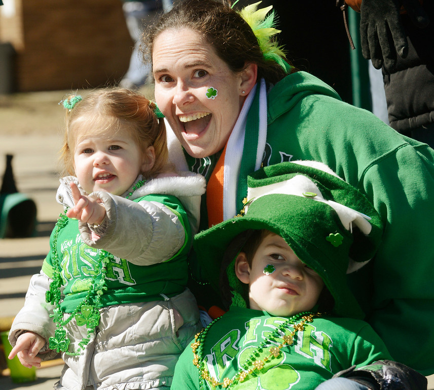 Description of . Maribeth Joeright/MJoeright@News-Herald.com Nicole McHale of Moreland Hills watches the 147th annual St. Patrick's Day parade with her children Lilly, 1, and Mikey, 4, March 17, 2014.