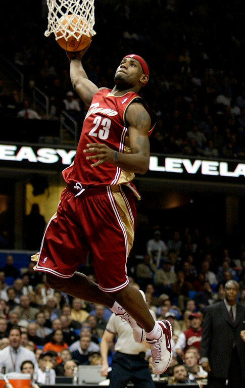Description of . Cleveland Cavaliers' LeBron James dunks the ball against the Denver Nuggets in the first quarter Wednesday, Nov. 5, 2003 in Cleveland. (AP Photo/Ron Schwane)