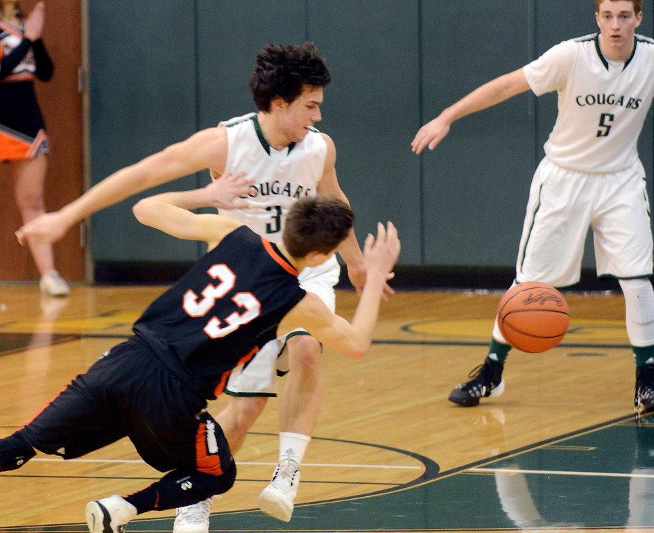 Description of . Maribeth Joeright/MJoeright@News-Herald.com<p> Chagrin's Nate Diedrich and Lake's Brett Nalepa chase a loose ball in the fourth quarter of the Division II district final game, March 8, 2014 at Lakeside High School.