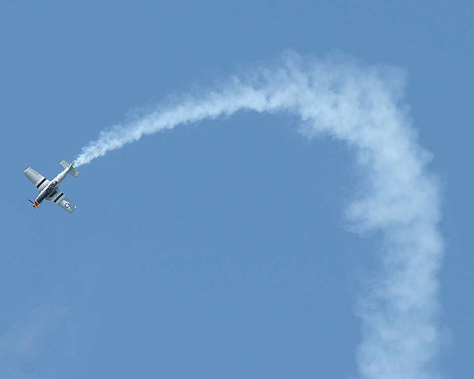 Description of . Jim Bobel/JBobel@MorningJournal.com A Titan T-51 makes a loop over the crowd at the Discover Aviation Air Show at the Lorain County Regional Airport. The plane is a three quater scale version of the World War II P-51 Mustang fighter plane. The plane is made in northeast Ohio.