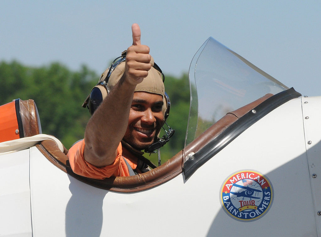 Description of . Jim Bobel/JBobel@MorningJournal.com A passenger in a Huey Davenport's 1929 bi-plane gives a thumbs up to the crowd as he taxis to the runway for a ride.