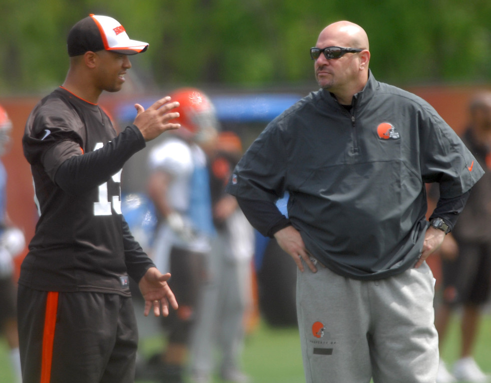 Description of . Michael Allen Blair/Digital First Media Browns' head coach Mike Pettine talks with wide receiver Mike Austin during Wednesday's organized team activities in Berea.