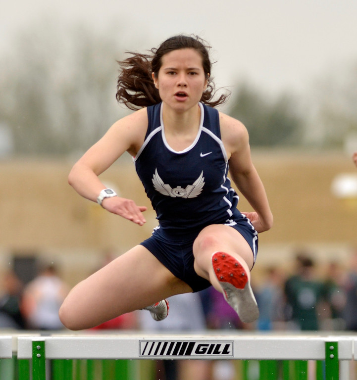 Description of . Jeff Forman/JForman@News-Herald.com Lilly Faulk, West Geuaga, competes in the 100 meter hurdle during the Mayfield 2014 Track and Field Invitaional May 9 at Mayfield High School.