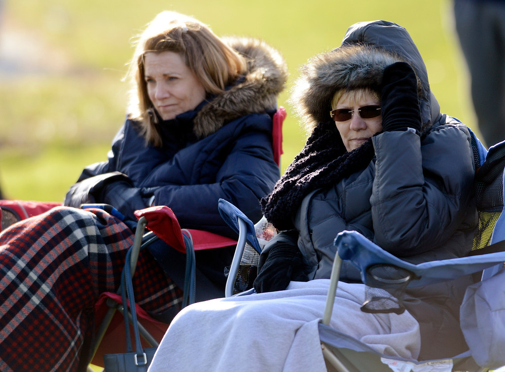 Description of . Maribeth Joeright/MJoeright@News-Herald.com<p> Jill Snyder, left, and Denise Clark of Russell Township bundle up to stay warm as they watch their sons Tim Snyder and Ross Clark play baseball against Kenston at West Geauga High School, April 22, 2014. Temperatures in the upper 40's and a prevailing wind from the north made watching the game a not so pleasant experience.