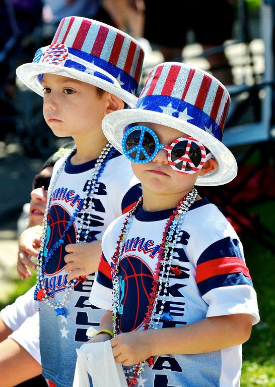 Description of . Jeff Forman/JForman@News-Herald.com Patriotic brothers Giovanni, left, and Aarmani Foti watch the Mentor Headlands July 4th Parade. They were at the parade with their grandmother, Patricia Foti, of Mentor.
