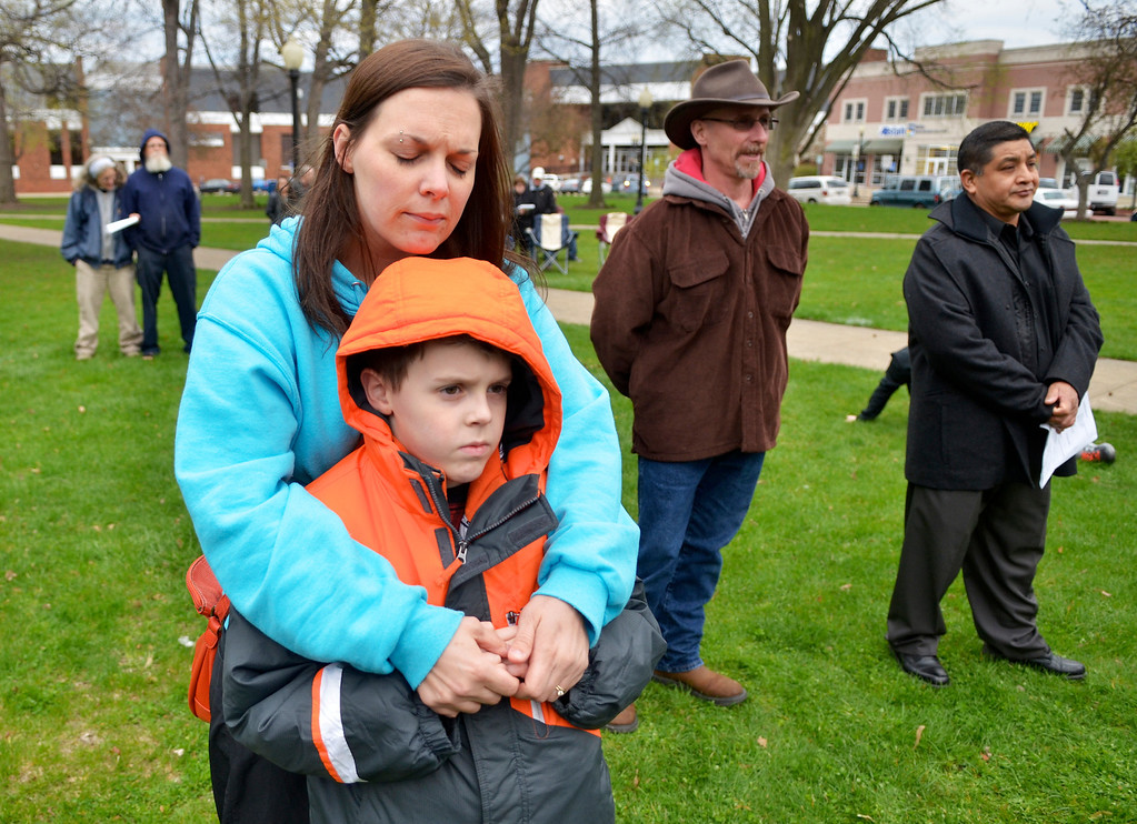 Description of . Jeff Forman/JForman@News-Herald.com Angela Hytree hugs her son Turner, 9, during a National Day of Prayer observance May 1 in Painesville. They live in Painesville.