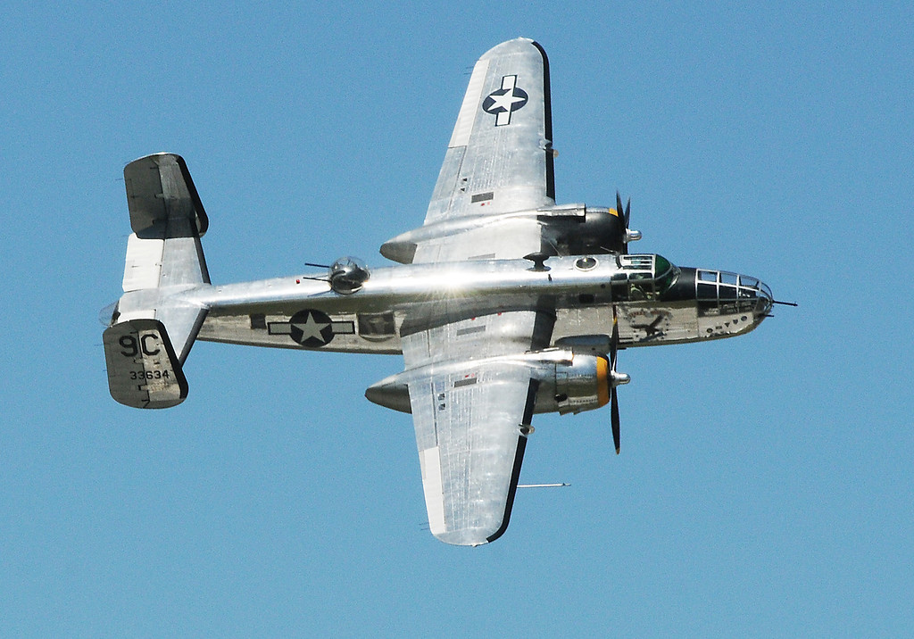 Description of . Jim Bobel/JBobel@MorningJournal.com The B-25 World War II Bomber Yankee Warrior makes a pass over the crowd Discover Aviation  Air Show at the Lorain County Regional Airport.