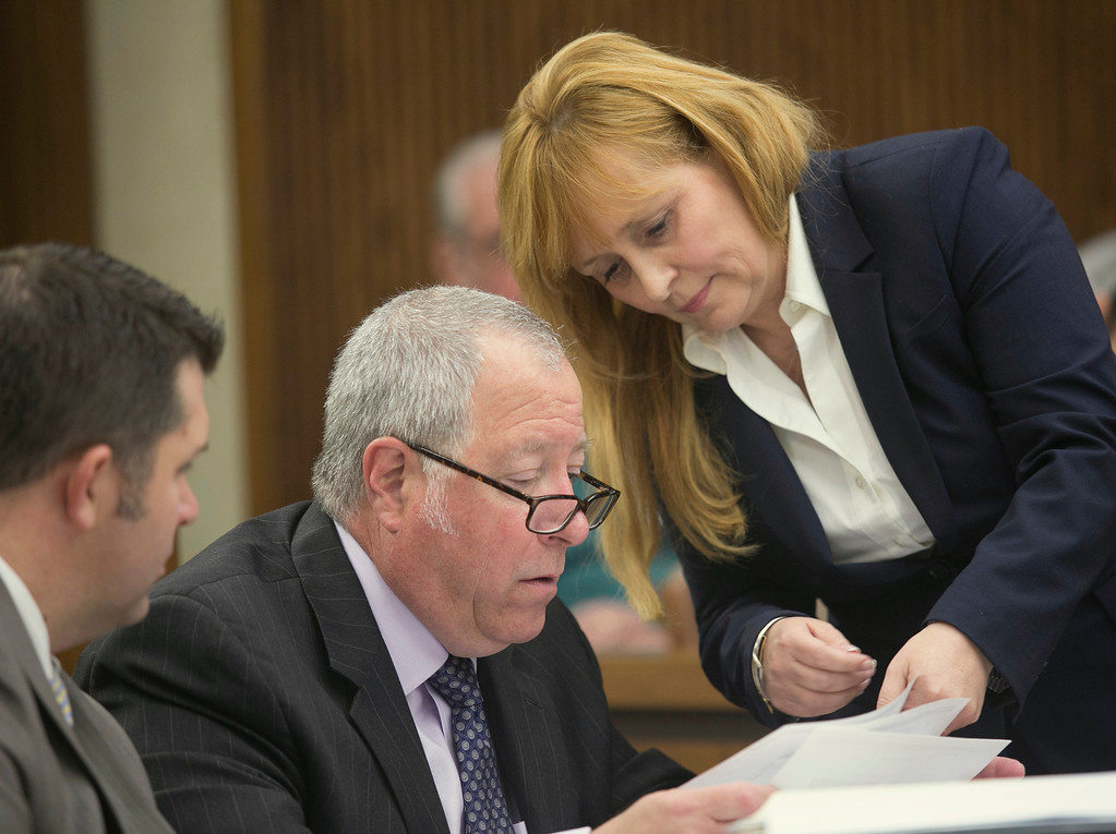 Description of . Michael Allen Blair/MBlair@News-Herald.com Prosecutor Lisa Neroda presents a document to defense attorney Michael J. Connick on day three of Kevin Knoefel's murder conspiracy trial in Lake County Common Pleas Court on June 4, 2014.