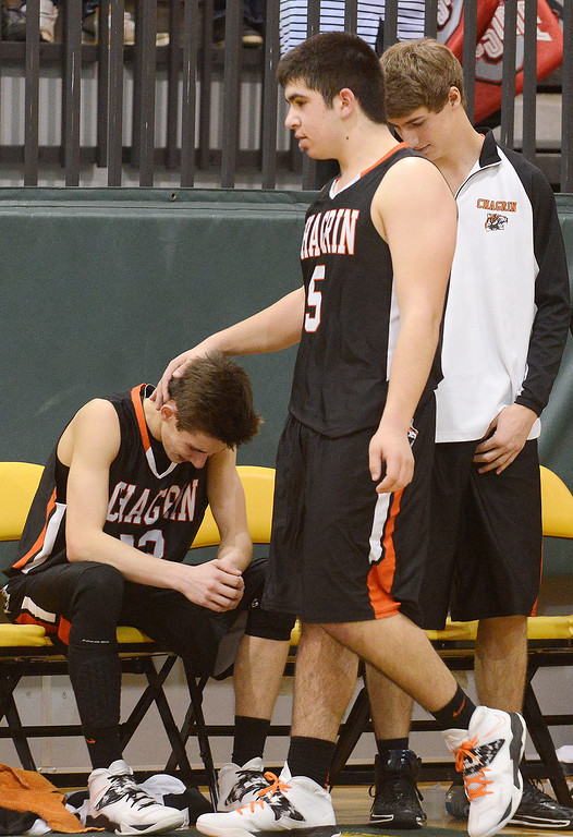 Description of . Maribeth Joeright/MJoeright@News-Herald.com Chagrin Falls' James Sferra consoles teammate Nate Diedrich after the team's loss to Lake Catholic in the Divison II district final game at Lakeside High School, March 8, 2014.