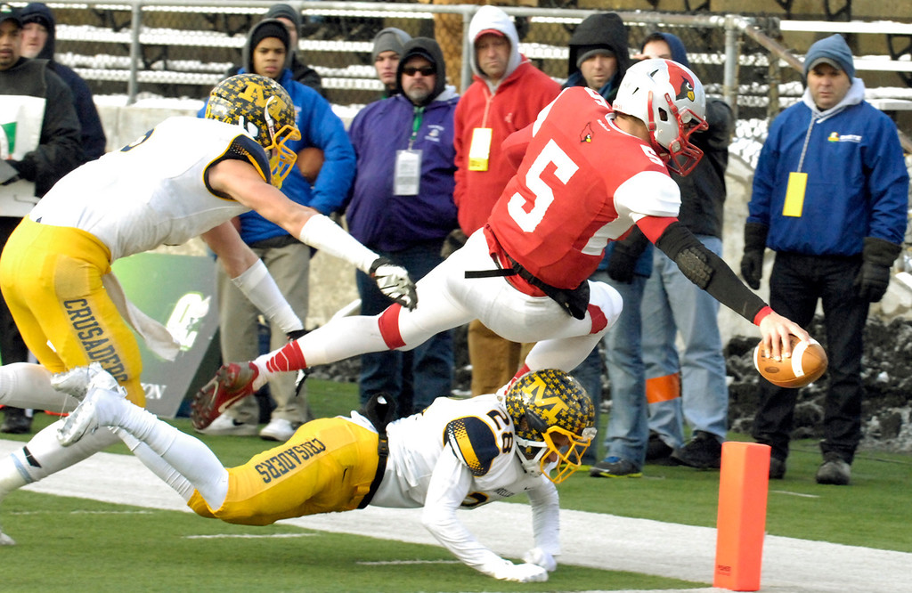 Description of . Maribeth Joeright/MJoeright@News-Herald.com<p>  Mentor's Conner Krizancic leaps into the end zone for a touchdown during the first quarter of the Division I state final game against Archbiship Moeller, Saturday, in Canton.
