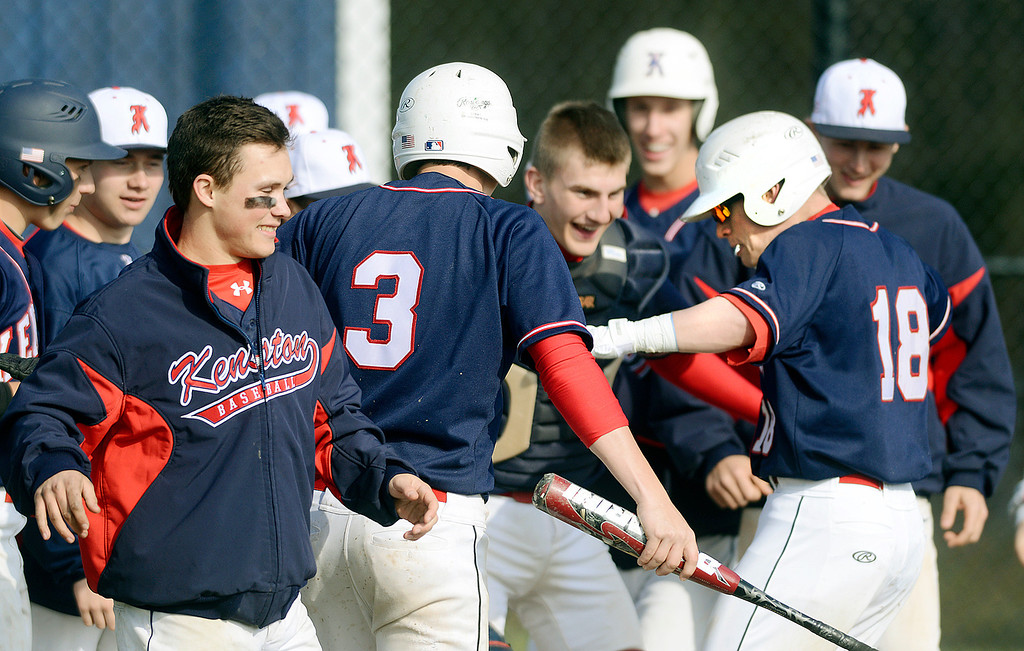 Description of . Maribeth Joeright/MJoeright@News-Herald.com<p> Members of the Kenston baseball team surround Jake Silberman, right, as he crosses home plate after hitting a two run home run in the third inning against West Geauga High School, April 22, 2014. Kenston won by a score of 16-3.